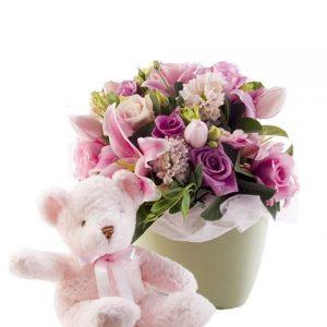 Centro con rosas y peluche