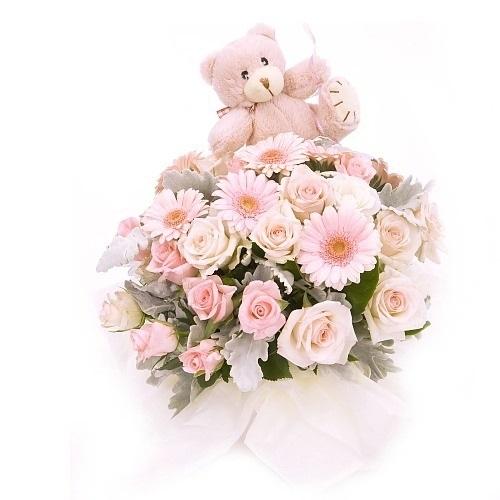 Centro de rosas con peluche bebé