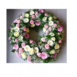 Corona de rosas y gerberas